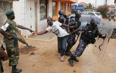 Photos: As votes are counted in Uganda, opposition leader is arrested