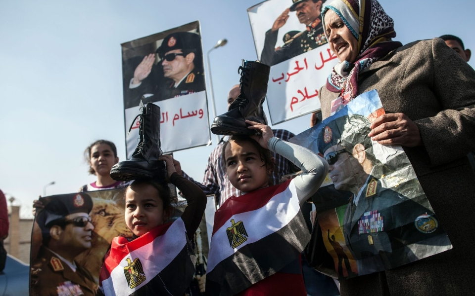 Sisi supporters put shoes on their heads