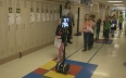 Meet the girl with a neurological disease who uses a robot for school