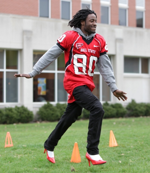Ball State University football player Jamill Smith takes part in a 2011 Walk a Mile in Her Shoes event in Muncie, Ind.