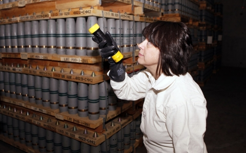 Debra Michaels, a chemical operations manager, inspects mustard agent shells in 2010 in a bunker at the Pueblo Army Chemical Storage facility in Pueblo, Colo.