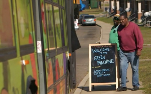 Customers in South Memphis walk into the Green Machine for fresh produce. The idea was based off a similar initiative in Chicago.