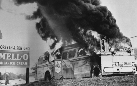 A Freedom Rider bus went up in flames in May 1961 when a fire bomb was tossed through a window near Anniston, Ala.