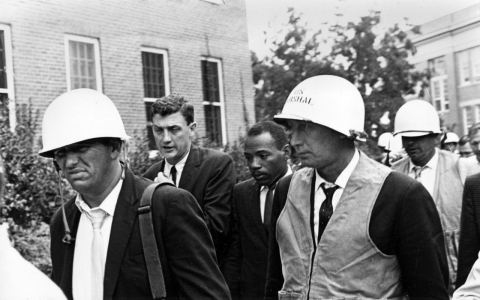 James Meredith, back center, is escorted by federal marshals as he appears for his first day of class at the previously all-white University of Mississippi, in Oxford, Miss., on Oct. 1, 1962.