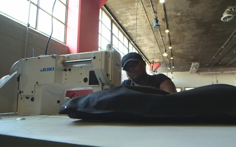 A seamstress sews heavy-duty coats for the homeless in The Empowerment Plan's workshop in Detroit.