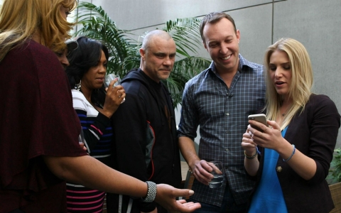 Correspondent Adam May, second from right, speaks with a group of experienced online daters in Los Angeles about the dos and don'ts of creating dating profiles.
