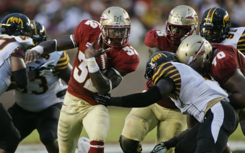 James Wilder Jr., runs past defenders in a game against Bethune-Cookman in 2012.