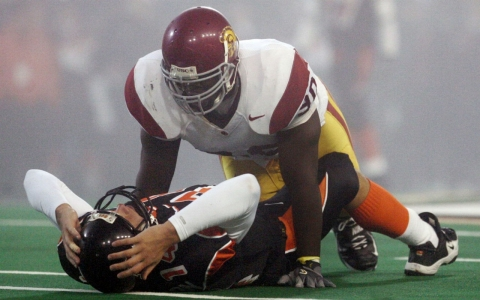 Frostee Rucker sacks an Oregon State quarterback in a 2003 game.