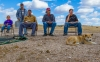 Men pass the time on the Pine Ridge Reservation, where the unemployment rate is more than 70 percent.