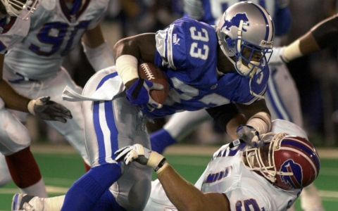 Former Detroit Lions running back Sedrick Irvin (33) makes a run during a 2000 game. Irvin played two seasons in the NFL.