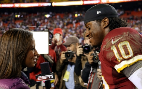 "ESPN sideline reporter Lisa Salters interviews Washington Redskins quarterback Robert Griffin III (10) last season. ESPN pays the NFL $1.95 billion a year for the rights to broadcast ""Monday Night Football."""