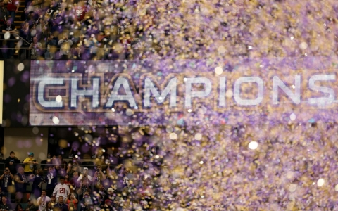 The Louisiana Mercedes-Benz Superdome scoreboard celebrates the Baltimore Ravens amid the confetti following Super Bowl XLVII in February.