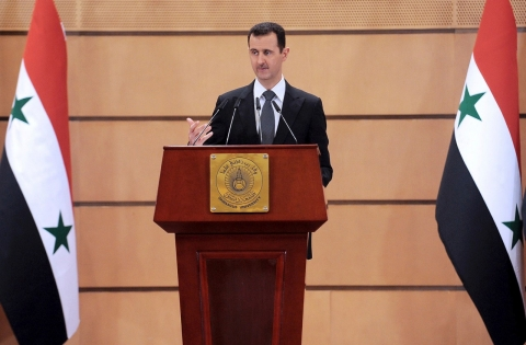 "Syria's President, Bashar Assad delivers a speech, in Damascus, Syria, Monday, June 20, 2011, saying ""saboteurs"" are trying to exploit legitimate demands for reform in the country.  ""There can be no development without stability, and no reform through vandalism. ... We have to isolate the saboteurs."" (AP Photo/SANA)"