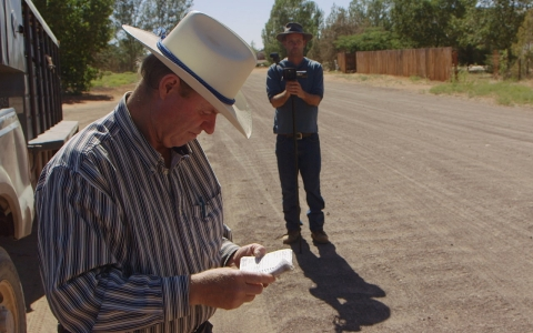 While being filmed by coworker for safety purposes, Isaac Wyler serves eviction notices to FLDS members who are living in homes that do not belong to them.