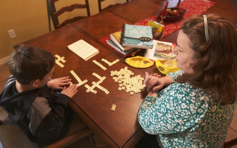 Rosanna Ward works on spelling with her 8-year-old son Joel.