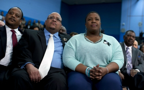 The Pendletons listen to President Obama speak during a speech on gun violence last year.