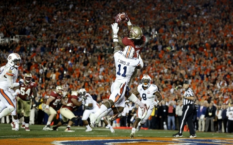 Florida State wide receiver Kelvin Benjamin catches a touchdown late in the fourth quarter of Monday's Vizio Bowl Championship Series National Championship Game. Benjamin was one of six Seminoles whose concussions were made public knowledge this season.