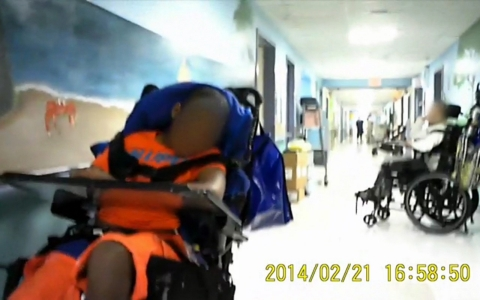 Hidden-camera footage taken inside a Florida nursing home shows many children with special needs sitting in hallways with no activities or toys.