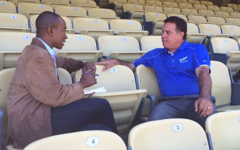 Stan Conte, right, speaks with America Tonight's Michael Okwu about concussions in baseball.