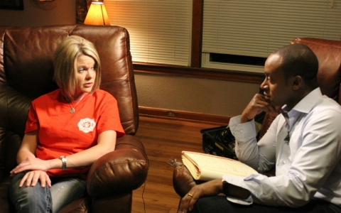 Kelly Pustejovsky, left, talks with America Tonight correspondent Michael Okwu about her late husband, Joey, and the 14 other men who lost their lives in the West Fertilizer Plant explosion last year.