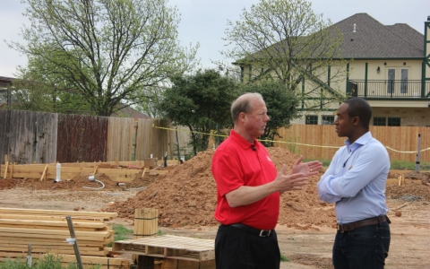 West Mayor Tommy Muska, left, talks to America Tonight correspondent Michael Okwu about the ongoing rebuilding process.