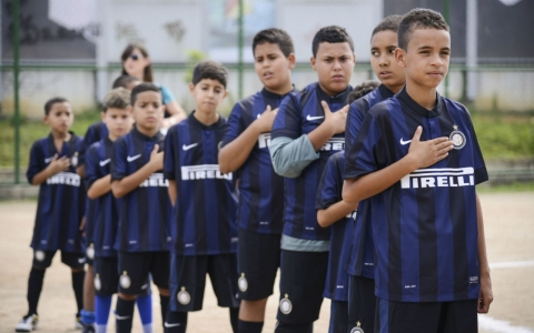 Young players from one of the local favelas in Rio line up before a game.
