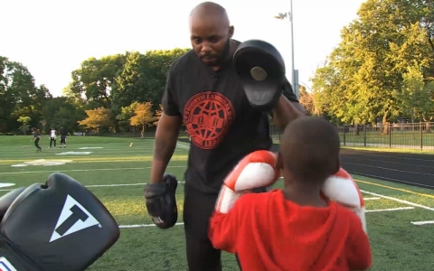 "Derek ""Shotgun"" Brown teaches kids in Chicago to box as part of his efforts to keep them away from gangs life."