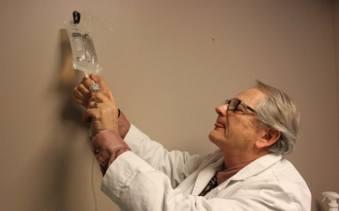 Dr. Glen Z. Brooks setting up an intravenous ketamine infusion at his New York office.