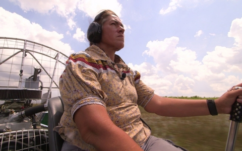 Betty Osceola aboard an airboat in the Everglades