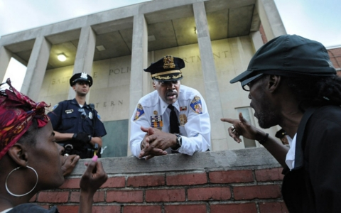 Lt. Col. Melvin Russell talks with protesters outside of the Western District Police Station on April 24, amid protests following the death of Freddie Gray.