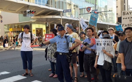 In Japan, (politely) protesting to preserve a pacifist nation