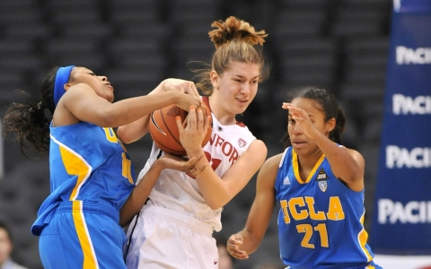 Toni Kokenis, middle, against UCLA in March 2011.