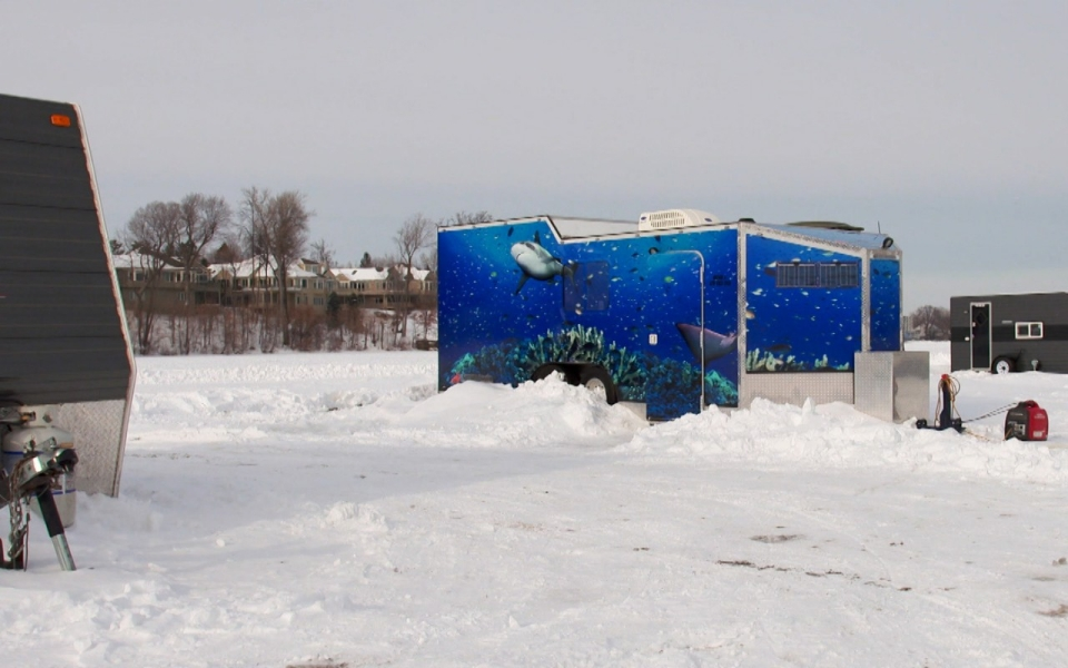Turning ice fishing into a video game al jazeera america for Mn ice fishing show