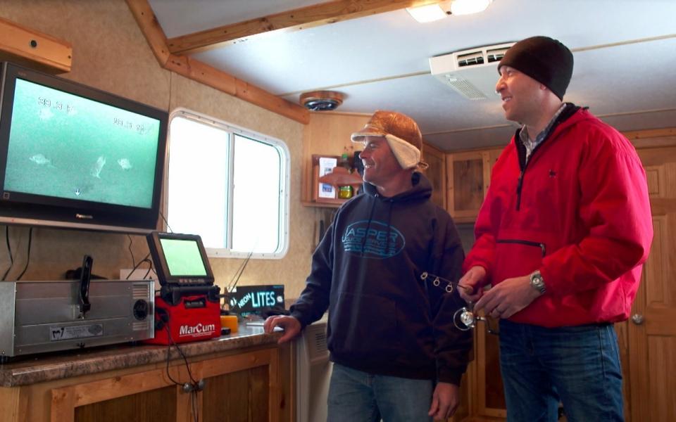 Turning ice fishing into a video game al jazeera america for Ice fishing show