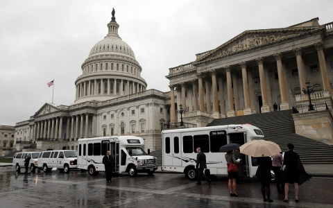 Members of the Senate Democratic caucus boards buses to go to the White House in front of the U.S. Capitol on October 10, 2013 in Washington, DC.