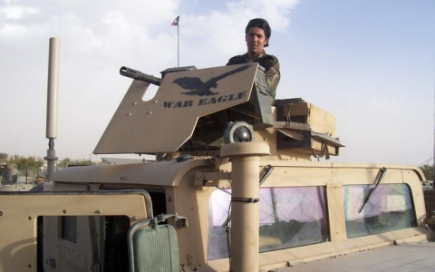 Mohammad Janis Shinwari with an Mark-19 grenade launcher on an Armored Humvee.