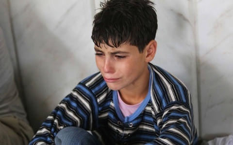 A young survivor of what activists say is a Wednesday gas attack in Damascus, Syria.