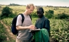 Jake reviews Nuru farmer agriculture data with Assistant Field Director James Magaigwa Chacha in Kuria West District, Kenya.