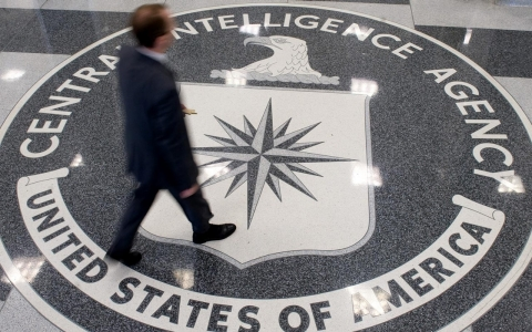A man crosses the Central Intelligence Agency logo in the lobby of CIA Headquarters in Langley, Va., on Aug. 14, 2008.