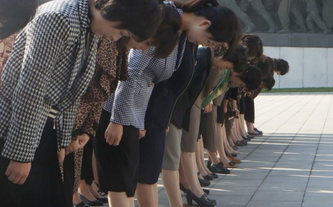 North Korean women bowing
