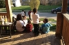 A mother who recently lost a child to SIDS sits with her two children and friends.