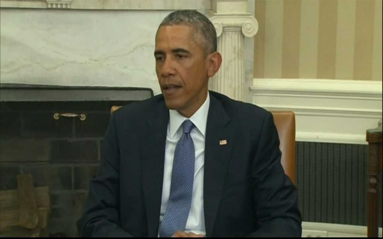 President Obama reacts to the shootings in Paris