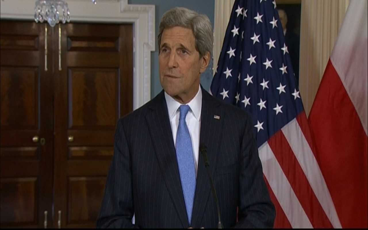 Secretary of State John Kerry reacts to the shooting in Paris