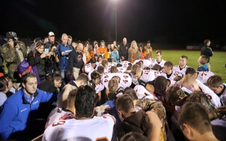 Praying after football games gets high school coach in trouble
