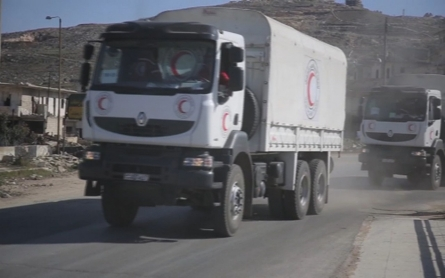 UN says aid trucks reach several besieged towns in Syria