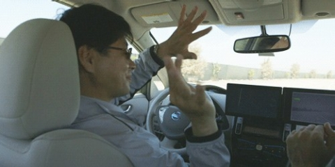 Nissan engineer Tetsuya Iijima goes hands-free in the autonomous LEAF prototype.