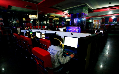 Customers use the web at an internet cafe.