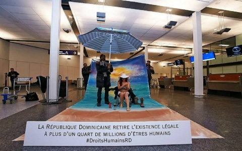 Protest calling for boycott of Dominican Republic tourism at a Montreal airport.