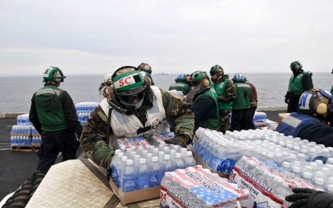 US Navy personnel aboard the USS Reagan assist with Fukushima disaster relief.