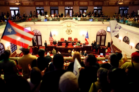Teachers protest in the gallery of the Senate after failing to reform a public pension system in Puerto Rico.